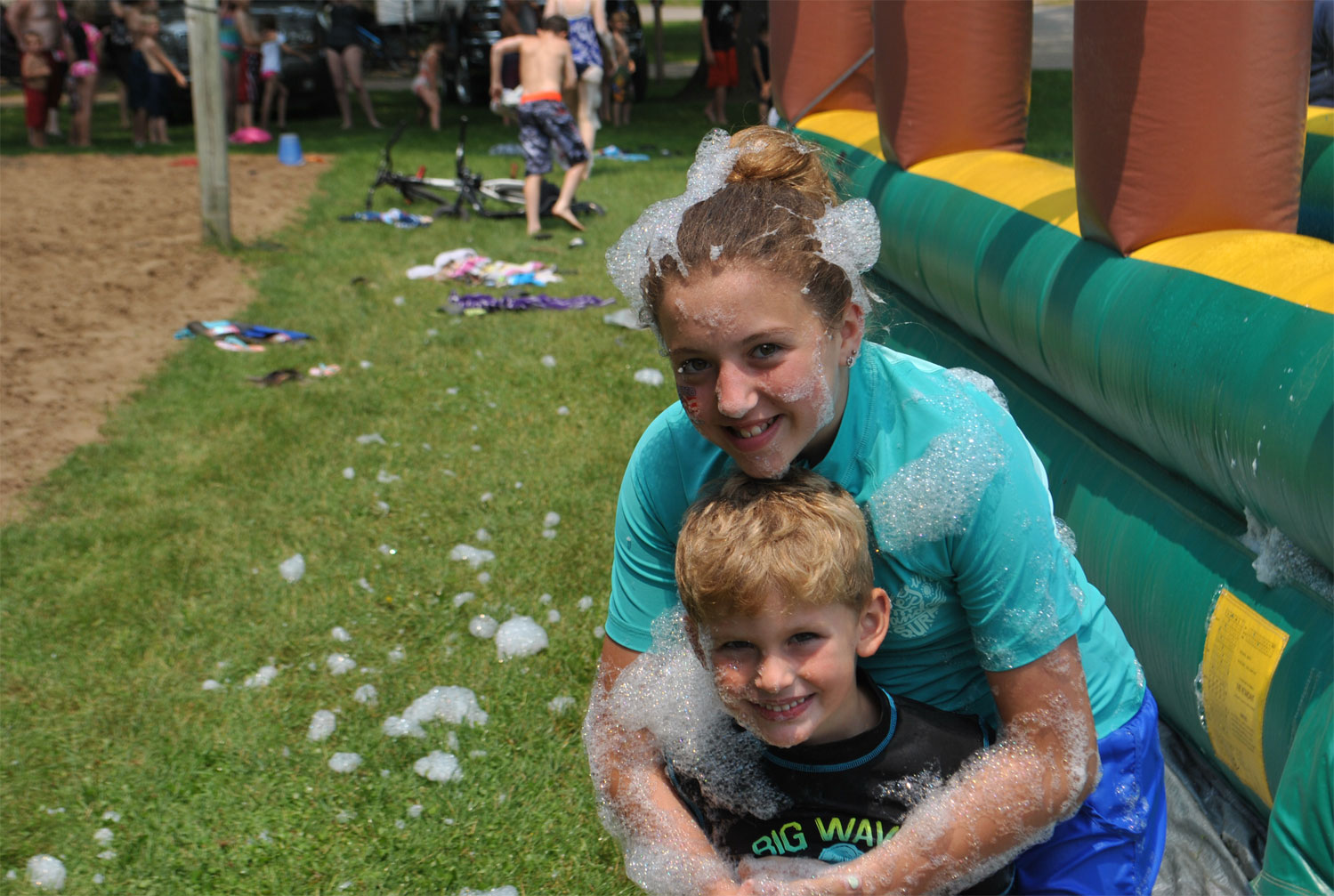 two children covered in suds at Gateway Park Campground